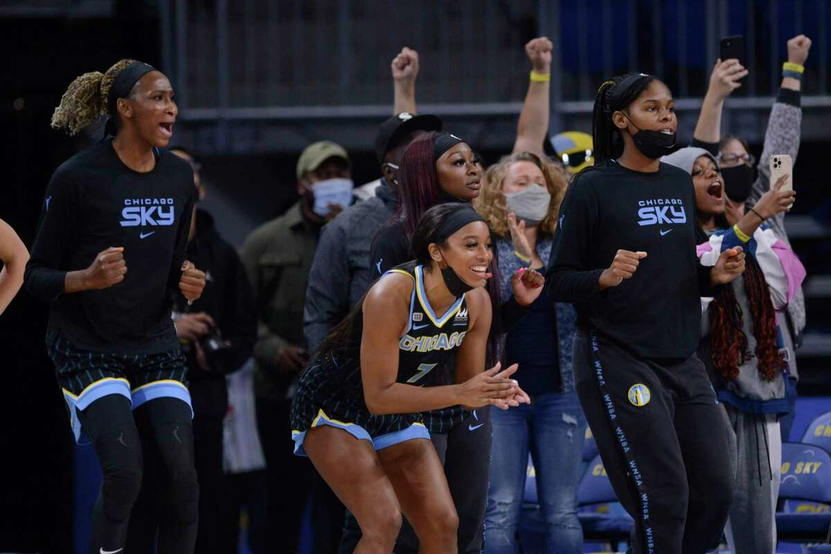 The Chicago Sky bench celebrate during the final seconds of Game 3 of their WNBA semifinal series against the Connecticut Sun on Sunday.