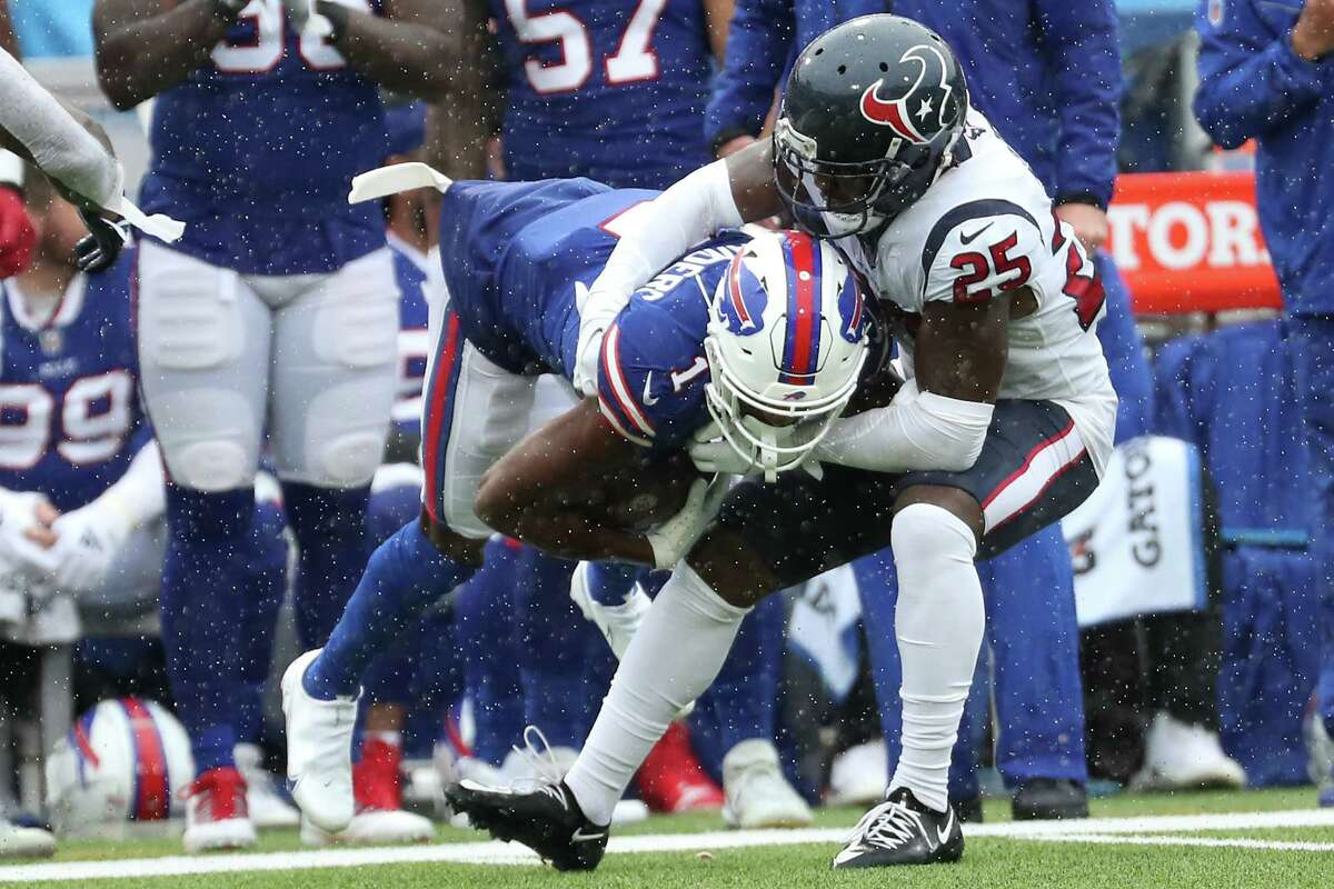 Houston Texans cornerback Desmond King II (25) stops Buffalo Bills wide receiver Emmanuel Sanders (1) during the second half of an NFL football game Sunday, Oct. 3, 2021, in Orchard Park, N.Y..