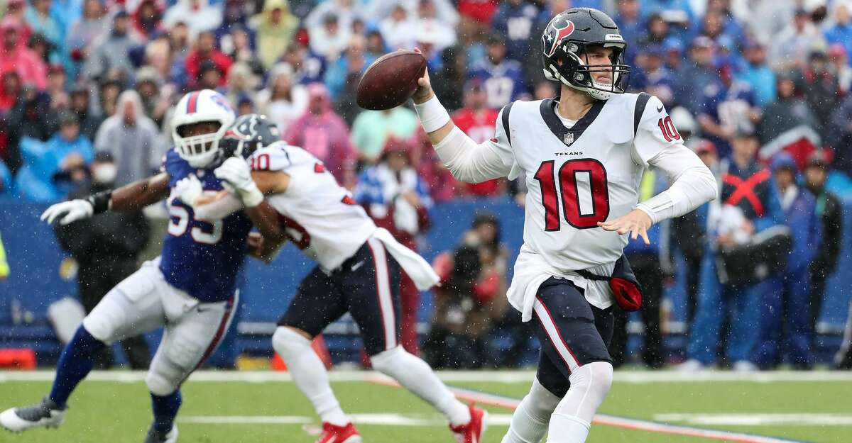 Houston Texans quarterback Davis Mills (10) rolls out to throw a pass against the Buffalo Bills during the second half of an NFL football game Sunday, Oct. 3, 2021, in Orchard Park, N.Y..