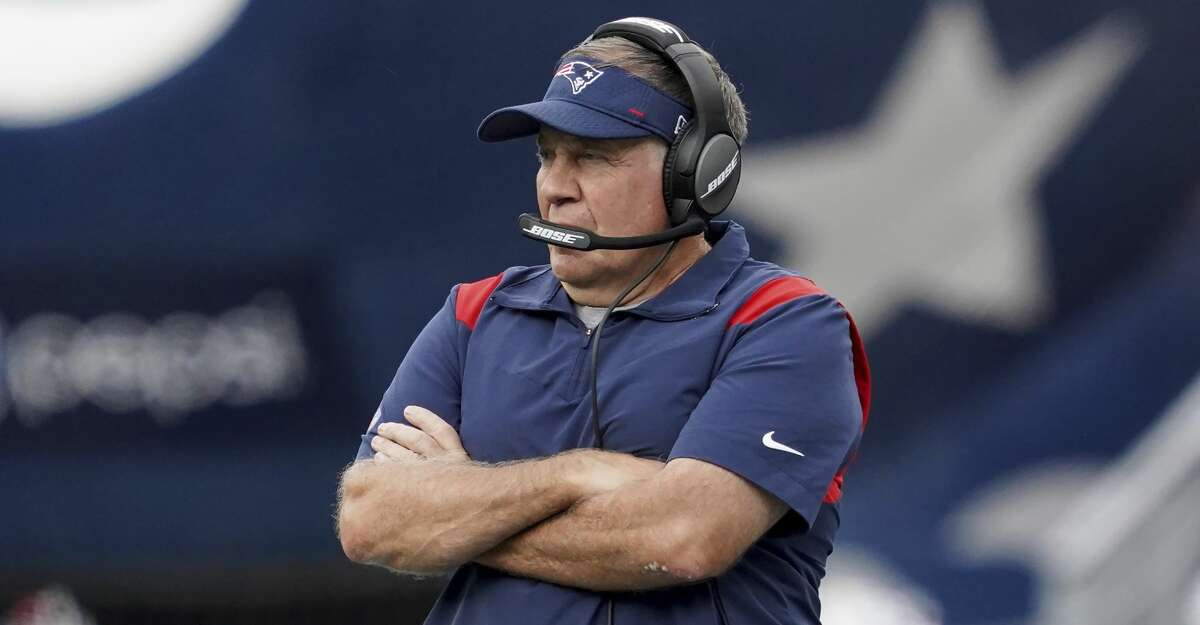 New England Patriots head coach Bill Belichick looks on from the sideline during the first half of an NFL football game against the New Orleans Saints, Sunday, Sept. 26, 2021, in Foxborough, Mass. (AP Photo/Mary Schwalm)