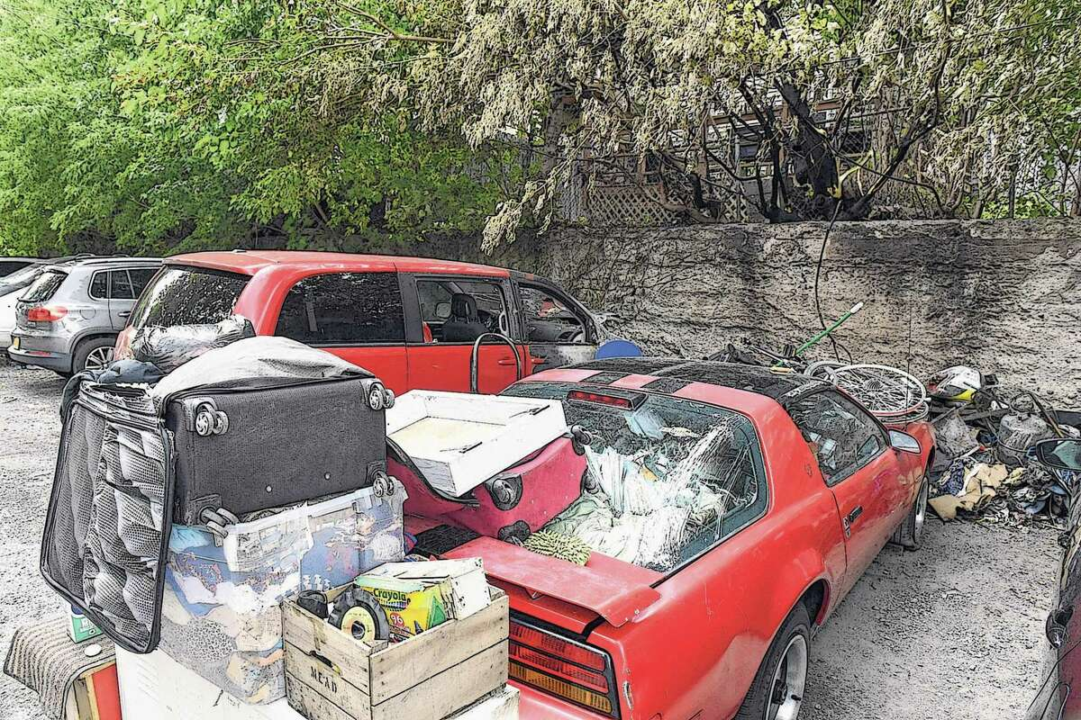 Abandoned cars and trash are part of the landscape in an alleyway off Knox Street between Myrtle Ave. and Morris Street on Thursday, Sept. 23, 2021, in Albany, N.Y. The area also serves as a parking space for nearby apartments. (Will Waldron/Times Union)