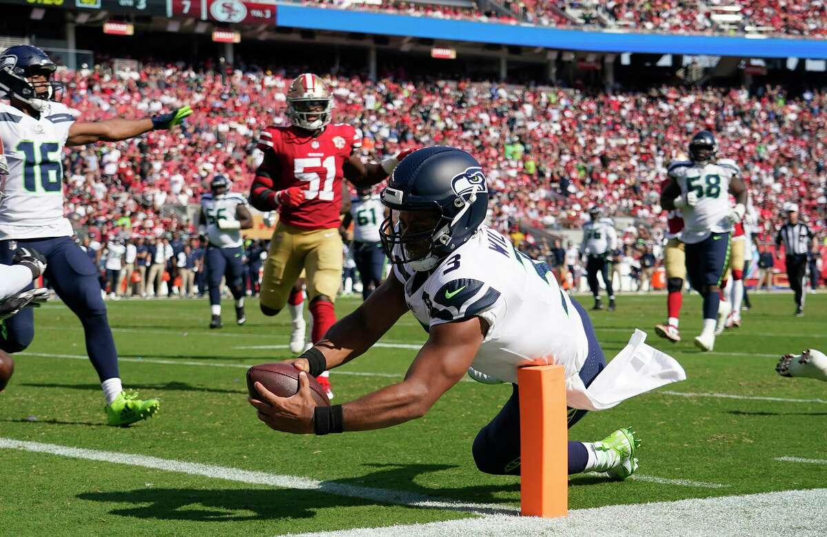 Seattle Seahawks quarterback Russell Wilson (3) runs for a touchdown against the San Francisco 49ers during the second half of an NFL football game in Santa Clara, Calif., Sunday, Oct. 3, 2021. (AP Photo/Tony Avelar)
