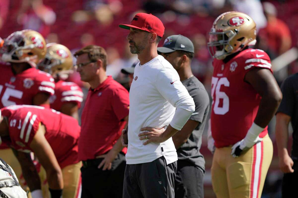 San Francisco 49ers head coach Kyle Shanahan watches players warm up before an NFL football game against the Seattle Seahawks in Santa Clara, Calif., Sunday, Oct. 3, 2021. (AP Photo/Tony Avelar)