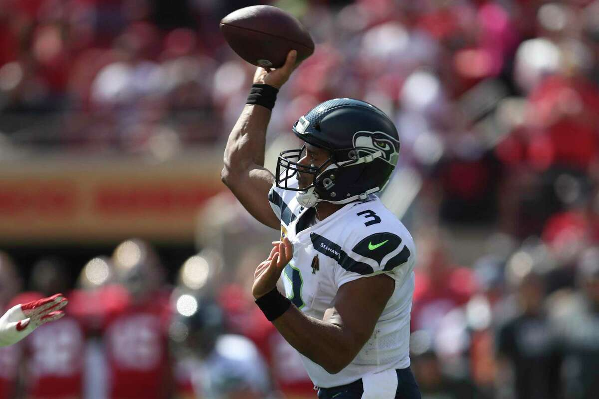 Seattle Seahawks quarterback Russell Wilson (3) passes against the San Francisco 49ers during the first half of an NFL football game in Santa Clara, Calif., Sunday, Oct. 3, 2021. (AP Photo/Jed Jacobsohn)