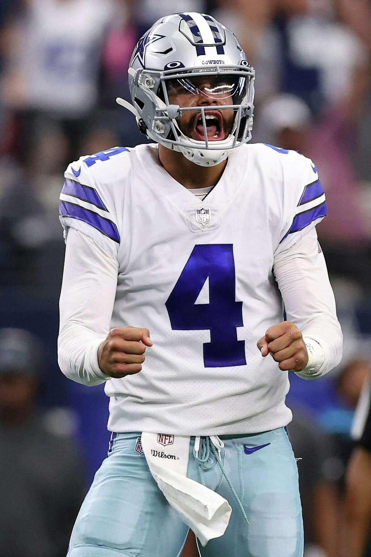 ARLINGTON, TEXAS - OCTOBER 03: Dak Prescott #4 of the Dallas Cowboys celebrates a touchdown during the second quarter against the Carolina Panthers at AT&T Stadium on October 03, 2021 in Arlington, Texas. (Photo by Tom Pennington/Getty Images)