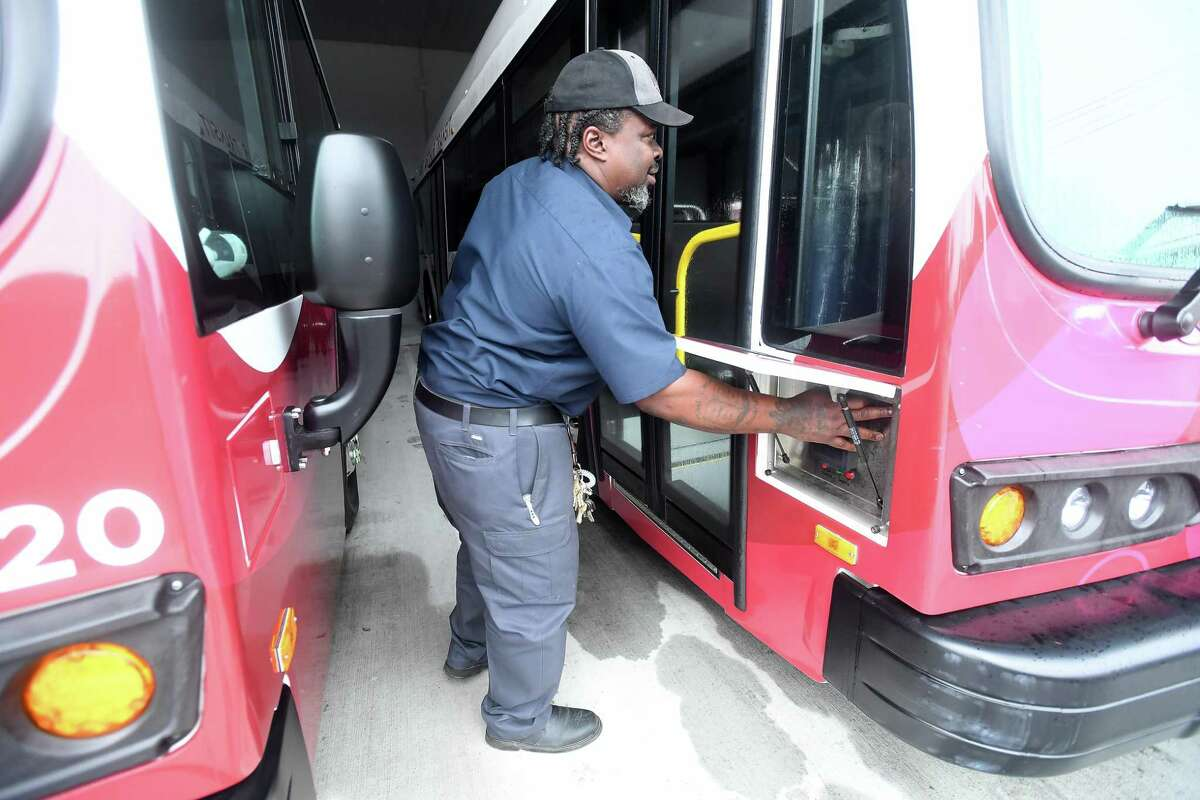 Port Arthur Transit maintenance supervisor Anthony Grogan powers up one of the buses in its growing fleet of zero emission all electric buses. Photo made Friday, October 1, 2021 Kim Brent/The Enterprise