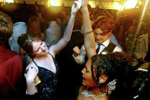 High school students dance during homecoming at Edwardsville High School Saturday evening.