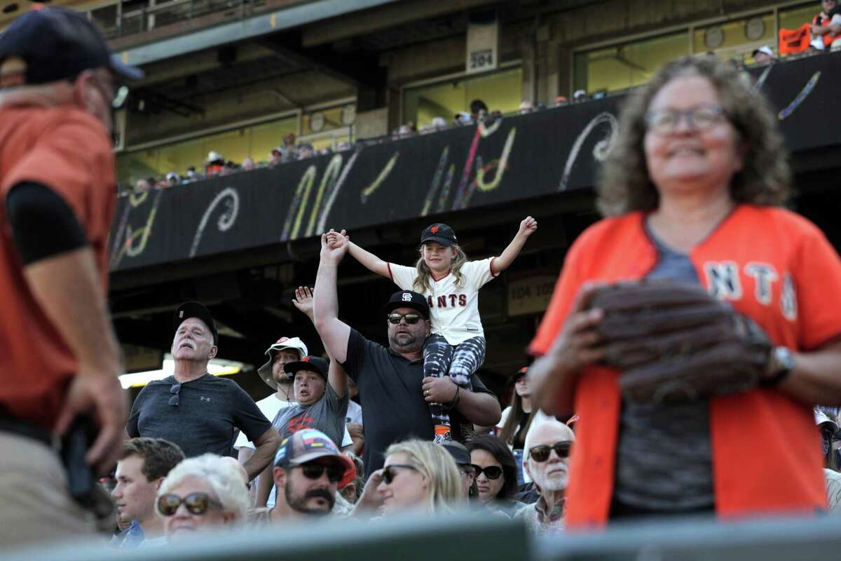 Fans celebrate in the top of the ninth before the San Francisco Giants defeated the San Diego Padres 11-4 to win the National League West at Oracle Park in San Francisco, Calif., on Sunday, October 3, 2021.