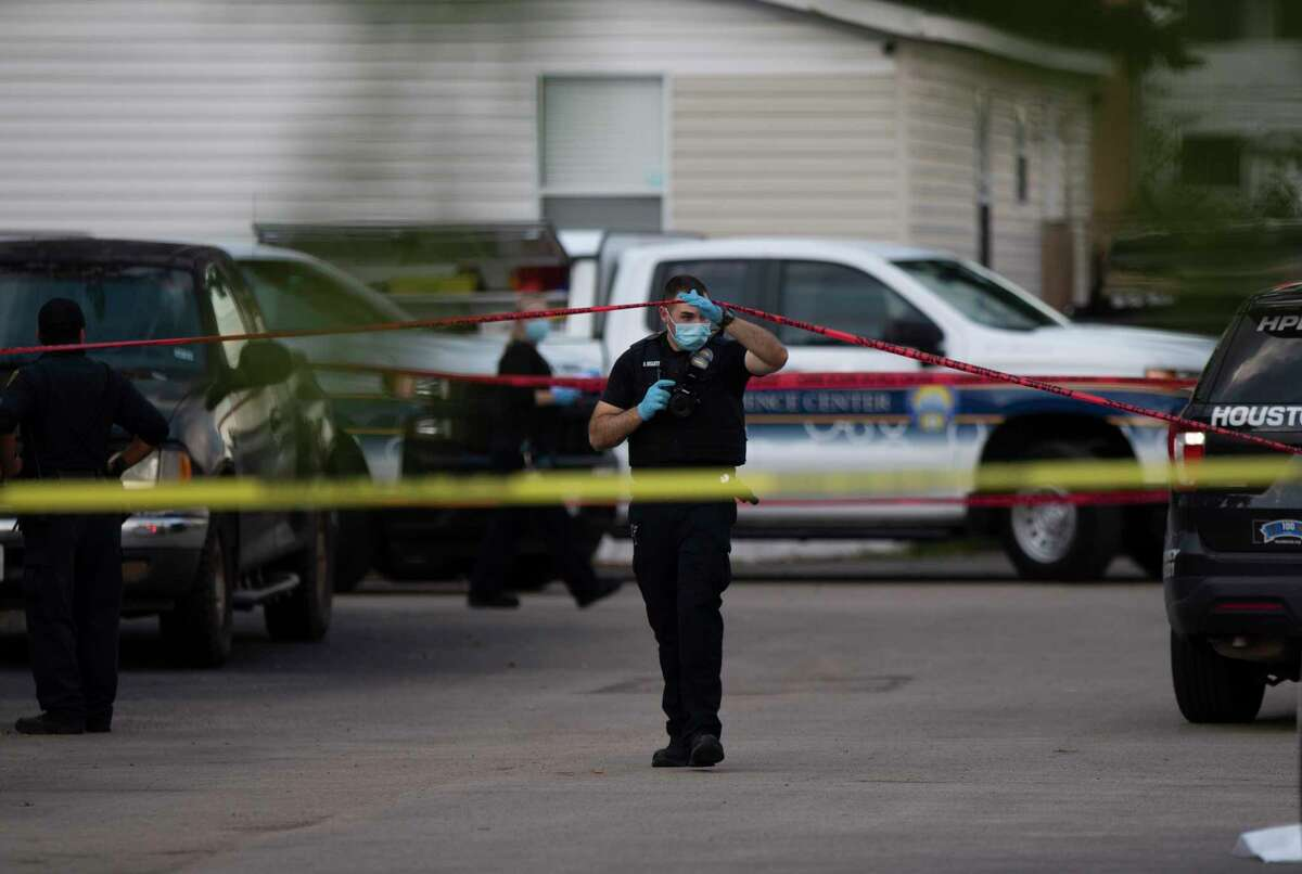 Houston Forensic Science Center Crime Scene Unit investigator collects evidences from a fatal shooting at 10800 block of Telephone Road Sunday, Oct. 3, 2021, at in Houston. One person deceased and three people injured at the mobile home park.