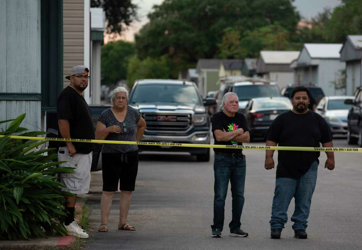 Neighbors watching authorities investigate a fatal shooting at 10800 block of Telephone Road Sunday, Oct. 3, 2021, at in Houston. One person deceased and three people injured at the mobile home park.