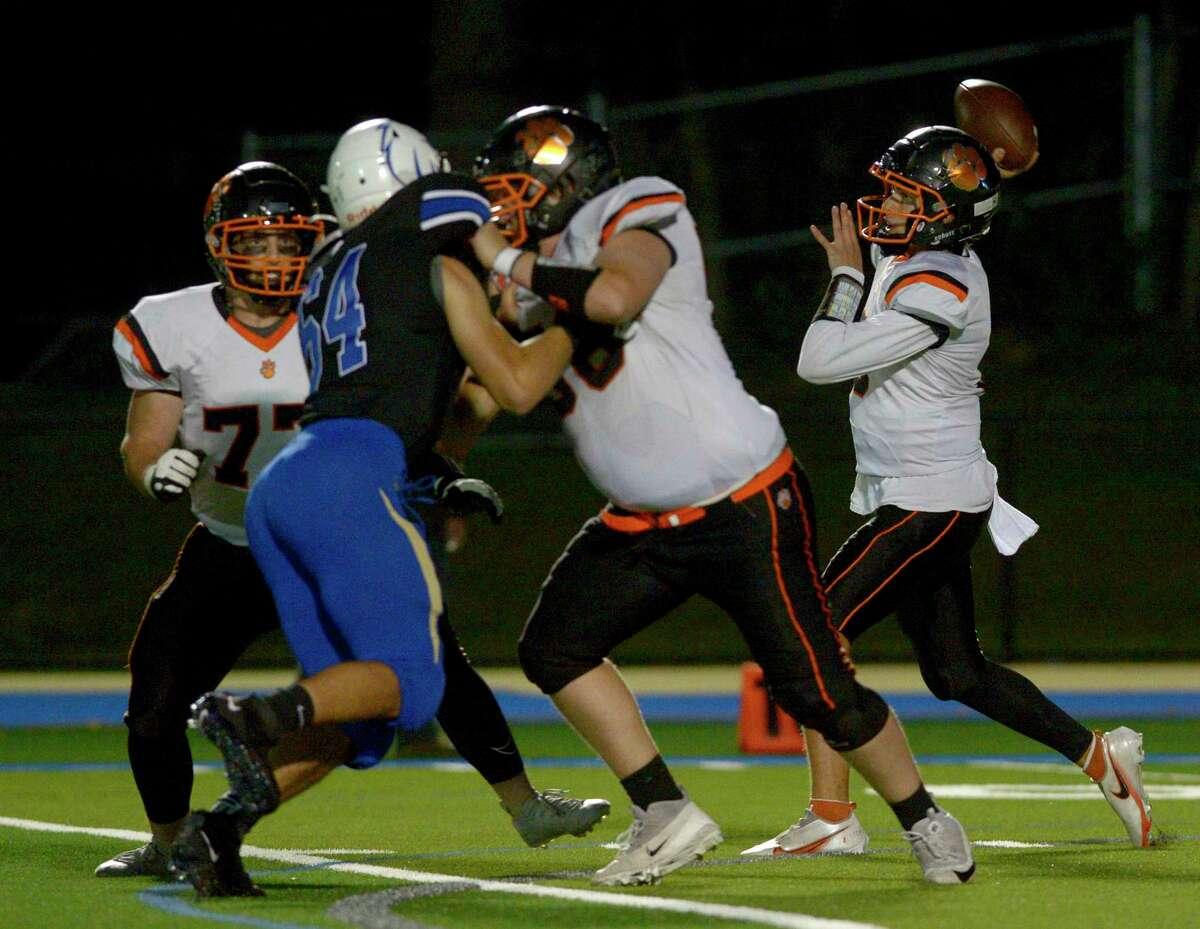 Ridgefield quarterback Justin Keller (6) throws a pass in the high school football game between Ridgefield and Newtown high schools. Friday night, October 1, 2021, at Newtown High School, Newtown, Conn.
