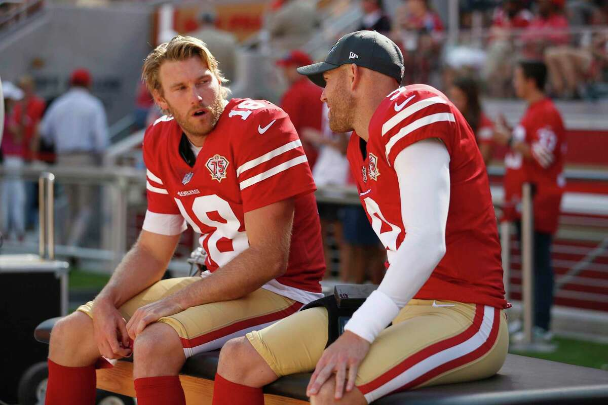 San Francisco 49ers kicker Robbie Gould (9) and San Francisco 49ers punter Mitch Wishnowsky (18) talk on the sidelines during an NFL football game against the Seattle Seahawks, Sunday, Oct. 3, 2021 in Santa Clara, Calif. (AP Photo/Lachlan Cunningham)