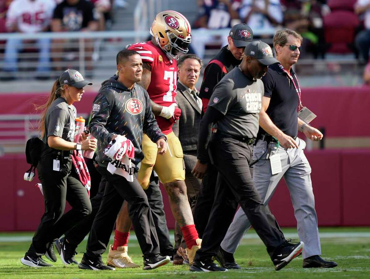 49ers tackle Trent Williams walks off the field after suffering a shoulder injury during the fourth quarter at Levi's Stadium.