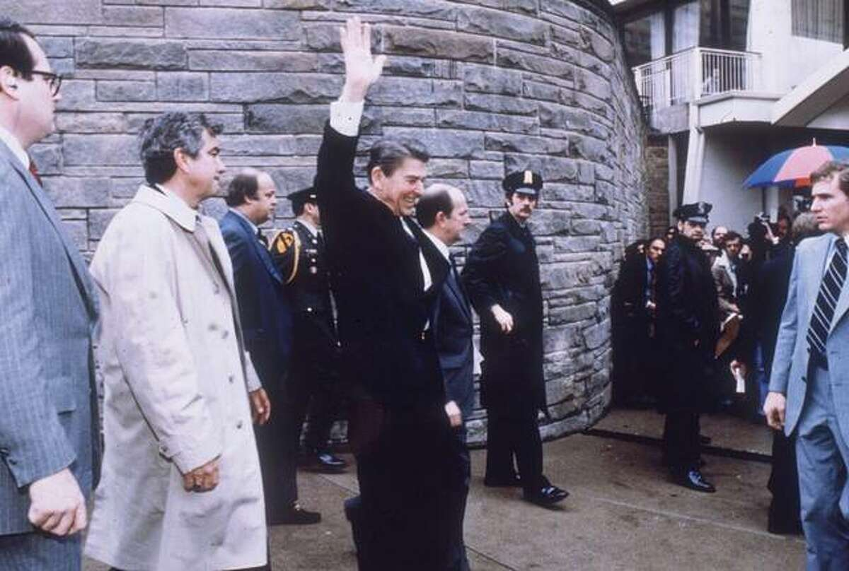 President Ronald Reagan waves to the crowd shortly before a 1981 assassination attempt outside the Hilton Hotel in Washington.