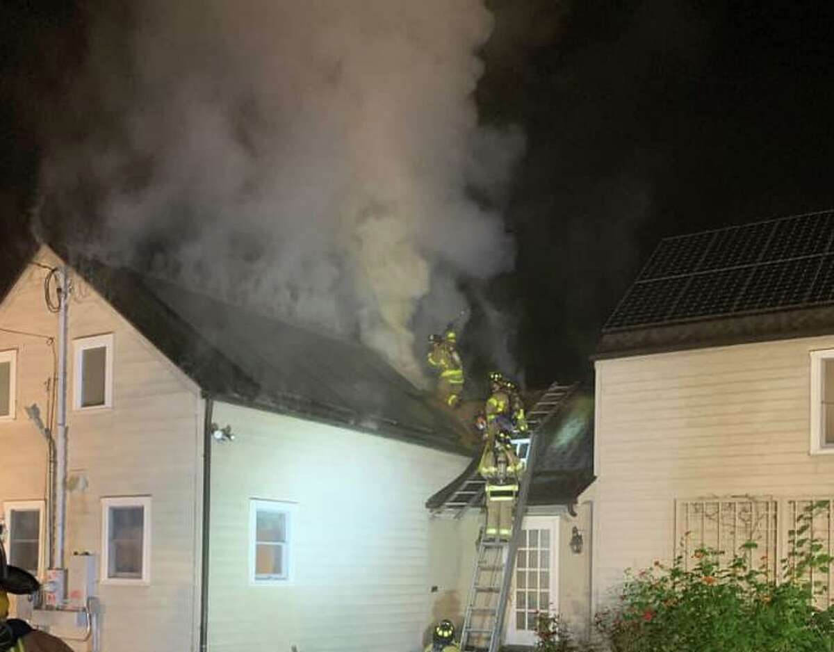 Crews extinguished a fire at a Marchant Road home in Redding, Conn., on Friday, Oct. 1, 2021.