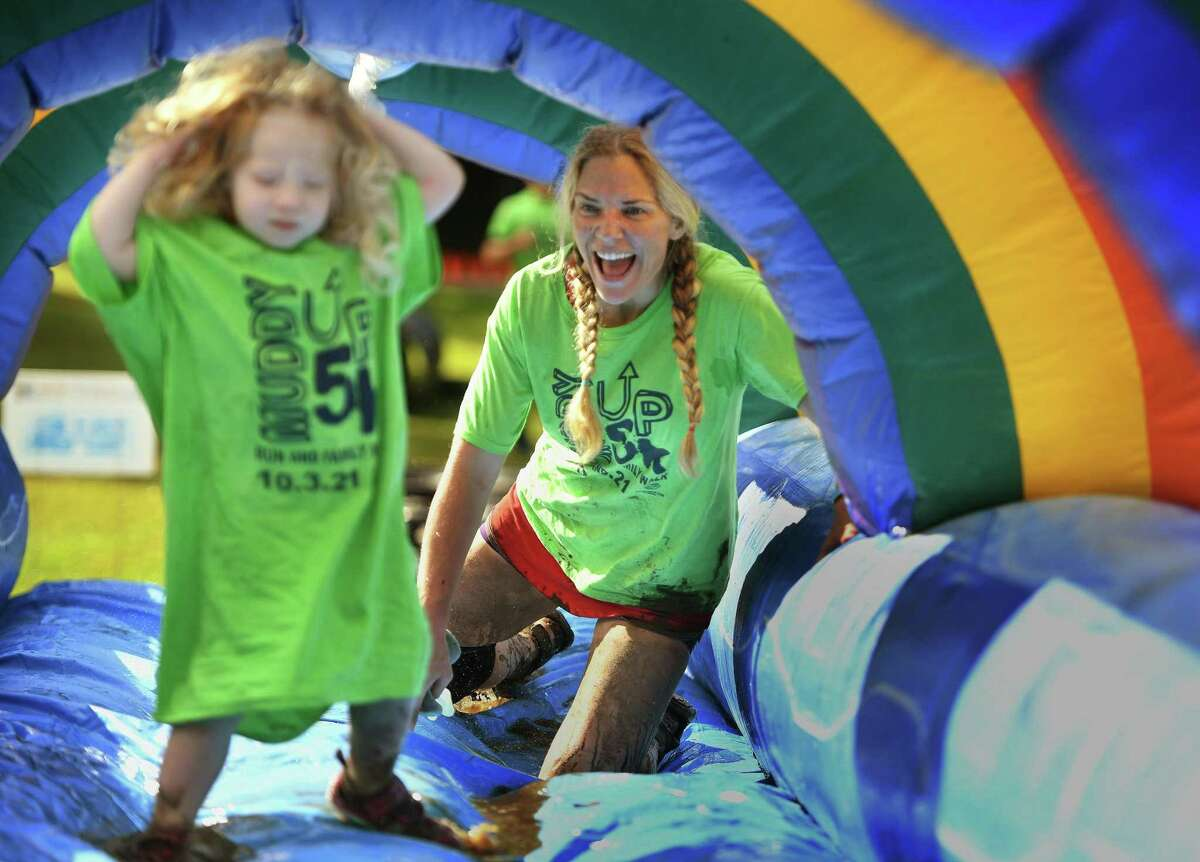 Hannah Bible, of Greenwich, cheers on her daughter, Alicebella Bible, 2, as they tackle the final obstacle.