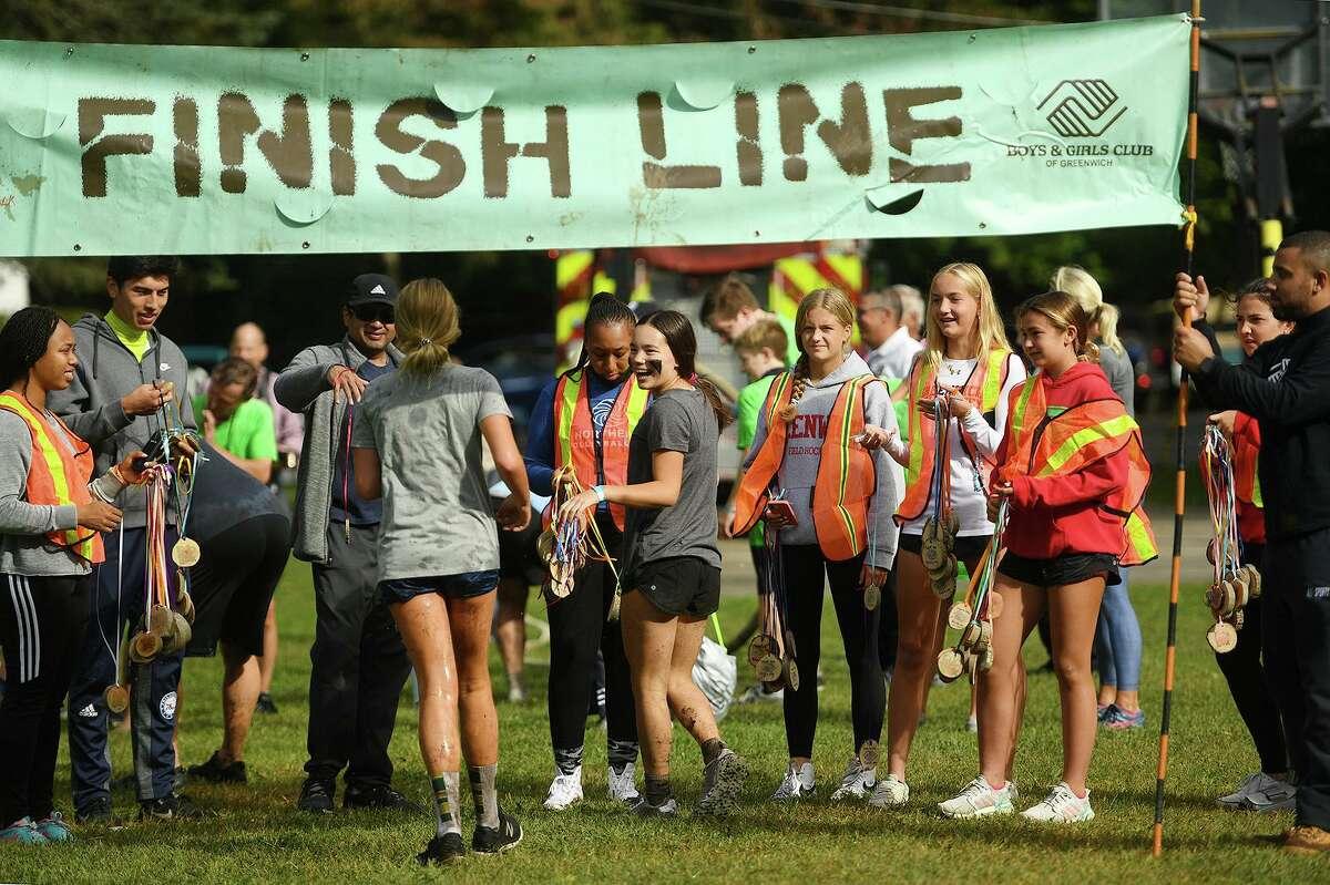 Runners cross the finish line on Sunday.