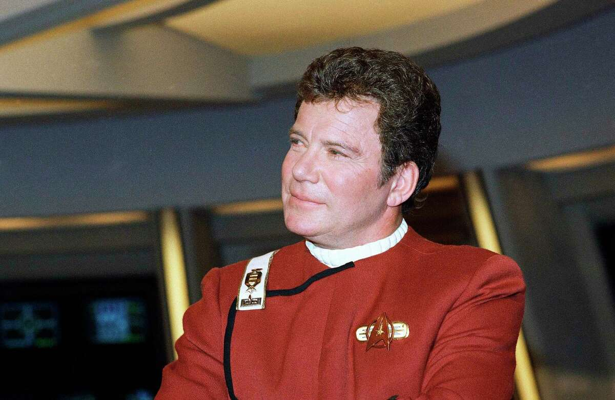 """In this 1988 file photo, William Shatner, who portrays Capt. James T. Kirk, attends a photo opportunity for the film """"Star Trek V: The Final Frontier."""" Star Trek's Captain Kirk is rocketing into space this month. Jeff Bezos' space travel company, Blue Origin, announced Monday, Oct. 4, 2021 that Shatner will blast off from West Texas on Oct. 12."""