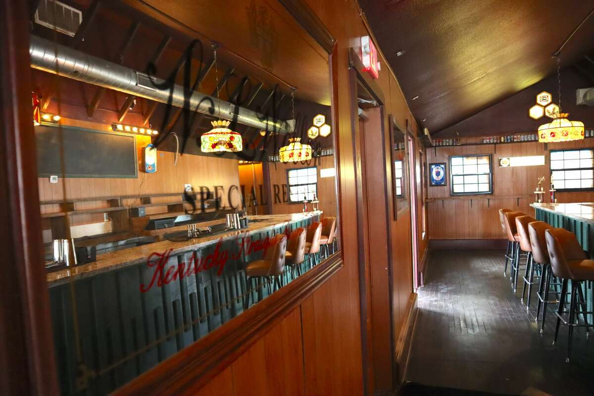 """Interior shots of the """"dad bar"""" aesthetic."""