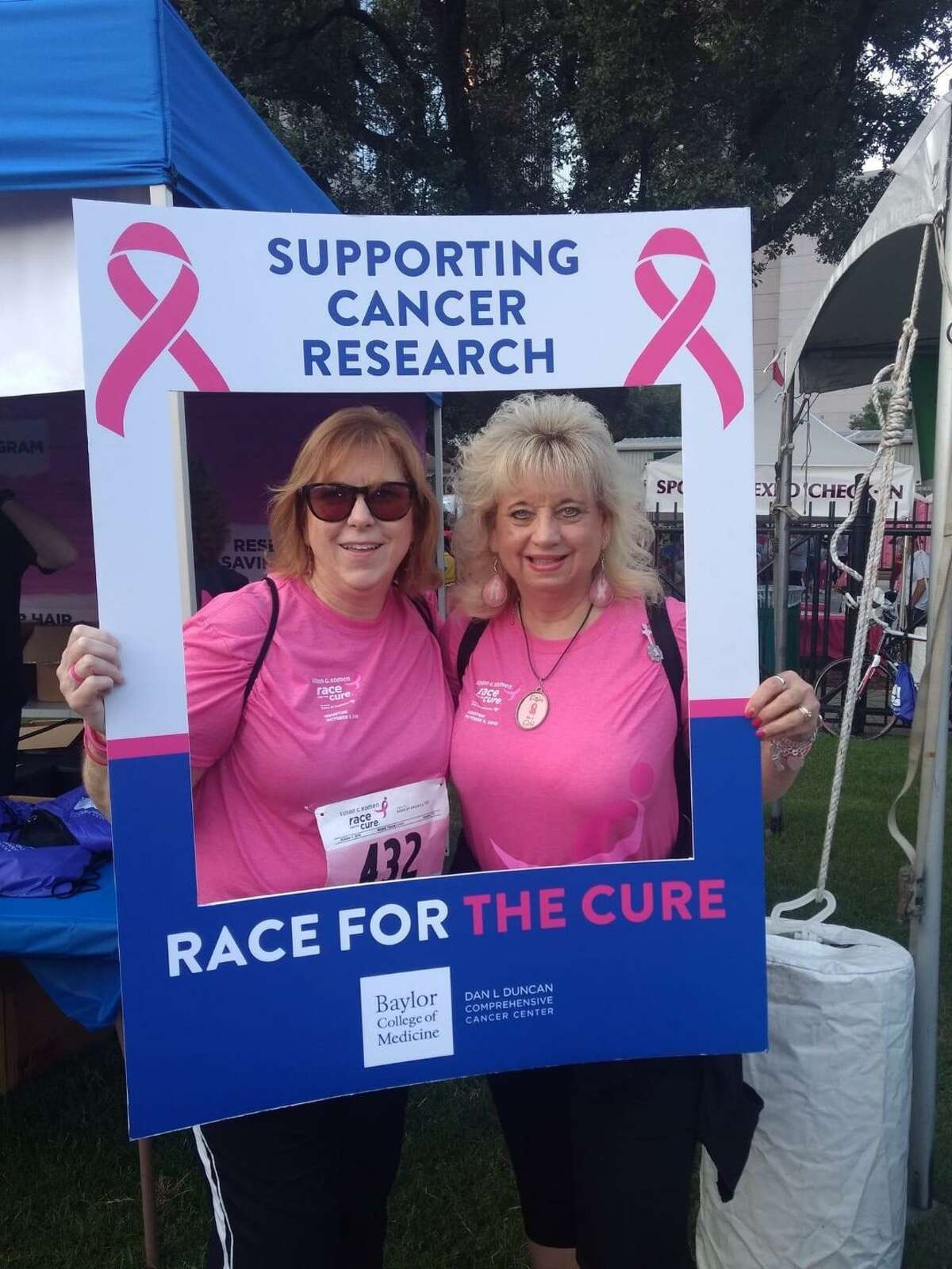 Rhonda Kirchman, right, and friend Darlene Kilburn participate in a Komen Houston Race for the Cure.