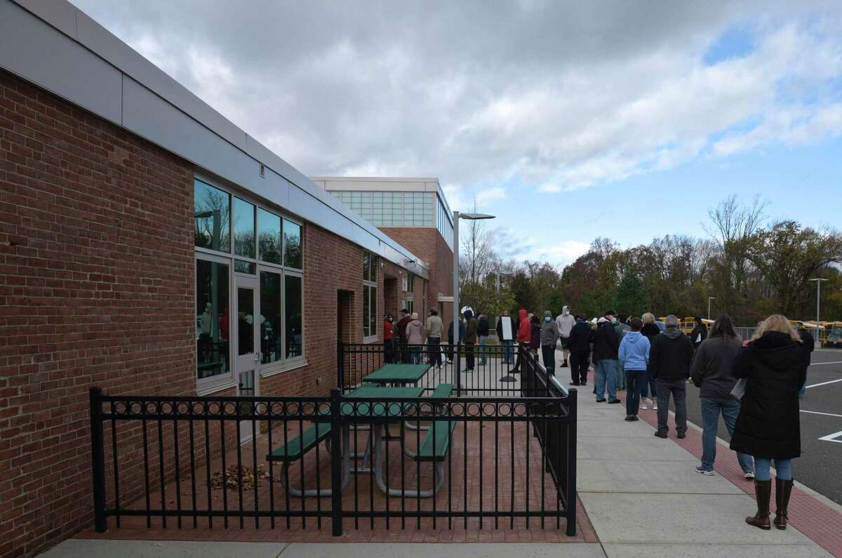 Voters line up to vote in the 2020 election at Meeting House School in New Fairfield, Conn. Due to construction, 108th district voters will instead cast ballots at the New Fairfield Middle School cafeteria this year.