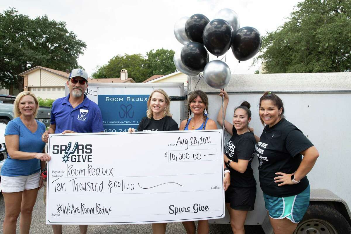 From left, Room Redux and Spurs Give representatives Beverly Davidek, Greg Vybiral, Angela Sparks, Susie Vybiral, Lorraine Benavides and Amanda Fite celebrate a $10,000 donation in August.