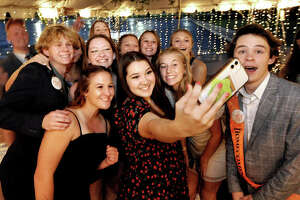 A group of Edwardsville High School students pose for a selfie during Homecoming night at the school Saturday.