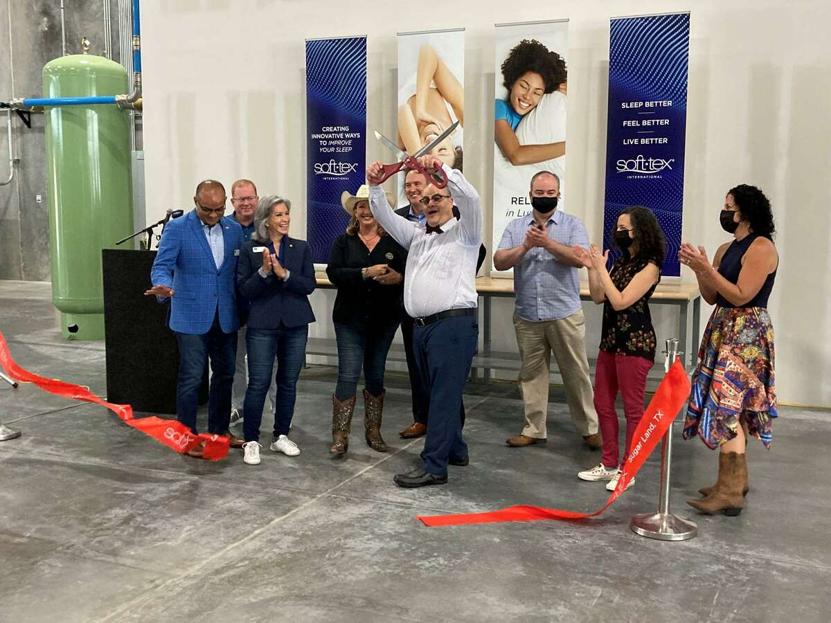 Soft-Tex principal Mark Smiderle cuts the ribbon on new Sugar Land facility.