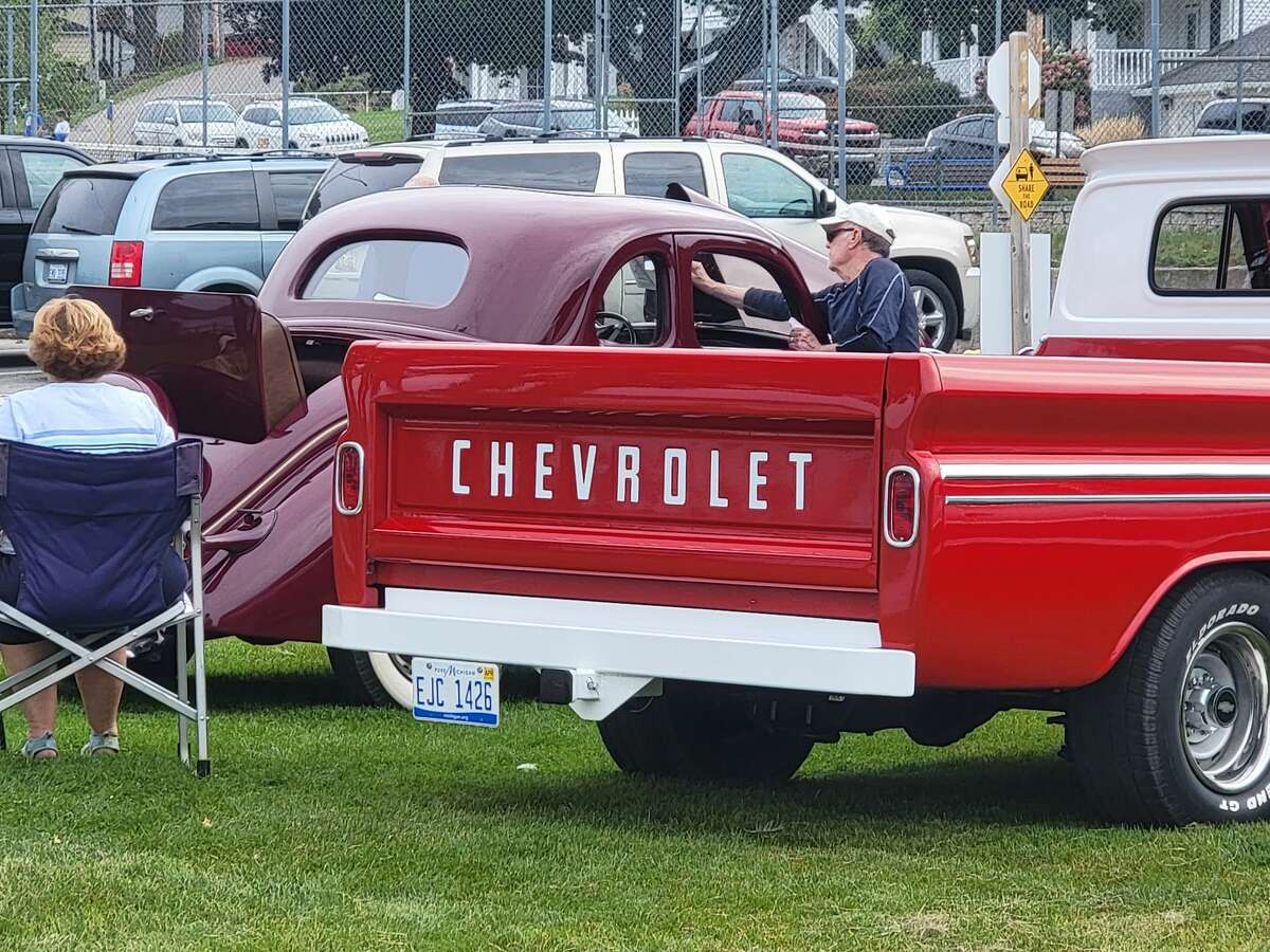 Car owners set up shop and talk with visitors to the Park and Shine car show during Beulah's Fall Fest.