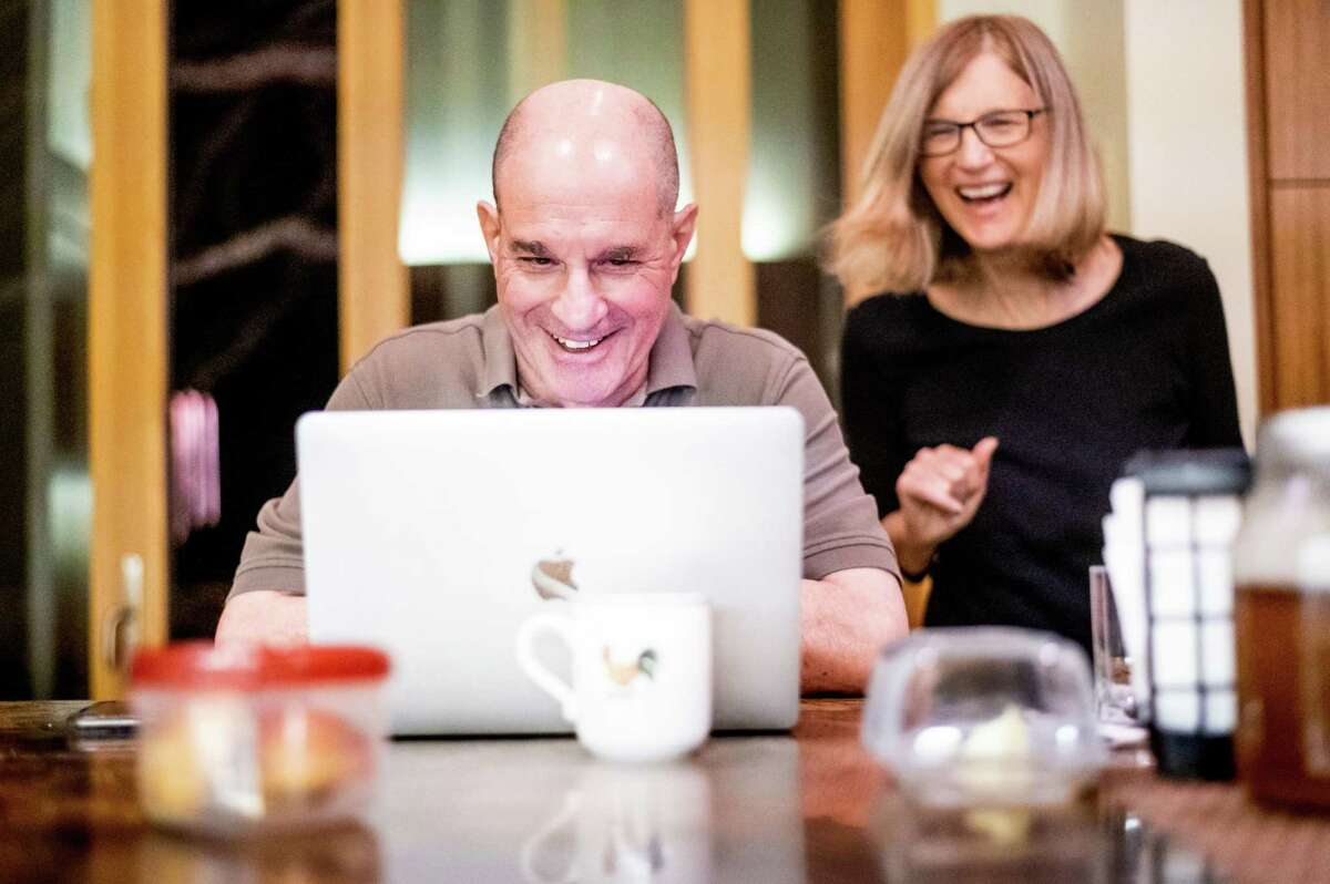 UCSF professor David Julius and his wife, UCSF professor Holly Ingraham, field messages after learning Julius was awarded the Nobel Prize in Physiology or Medicine on in Walnut Creek, Calif.