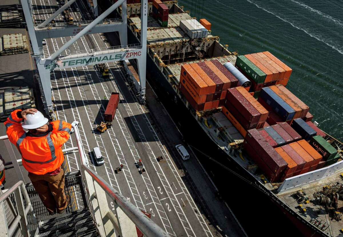 The Long Beach Express cargo ship has its cargo offloaded at the SSA Terminal in the Port of Oakland. Ports in the Bay Area aren't backed up, but there are major delays at other California ports.