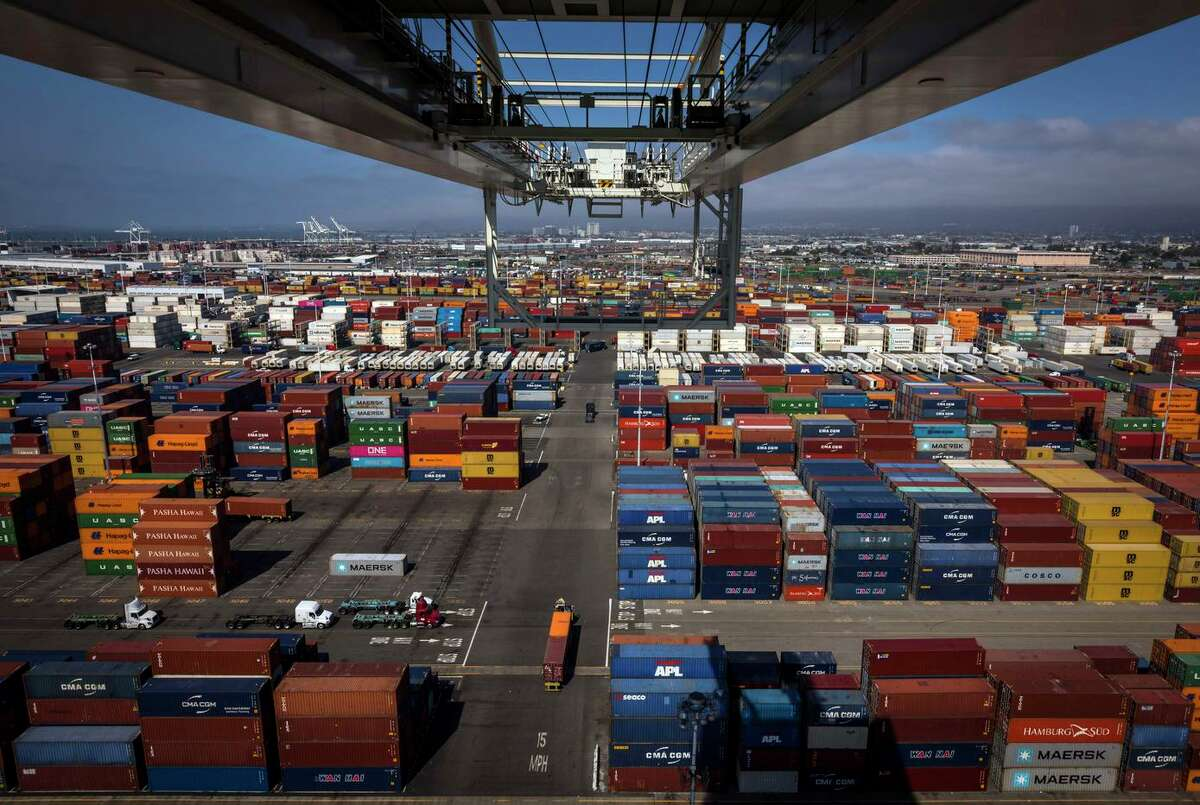 View from the top of a crane of unloaded cargo containers at the SSA terminal in the Port of Oakland.  The port says it cleared its backlog of ships in July, in part thanks to a labor agreement.