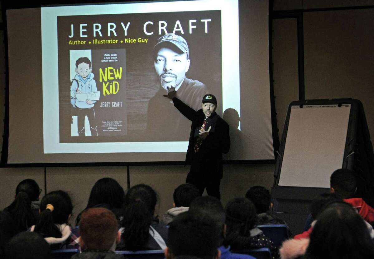 """Local author and cartoonist Jerry Craft celebrates his new book """"New Kid"""" Tuesday, February 26, 2019, at the Norwalk Public Library in Norwalk, Conn."""