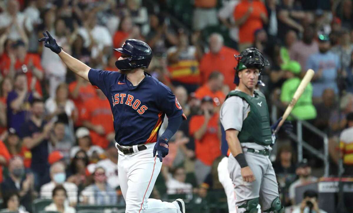 Houston Astros Chas McCormick celebrates his home run off of Oakland Athletics starting pitcher Cole Irvin during the second inning of an MLB baseball game at Minute Maid Park, Sunday, October 3, 2021, in Houston.