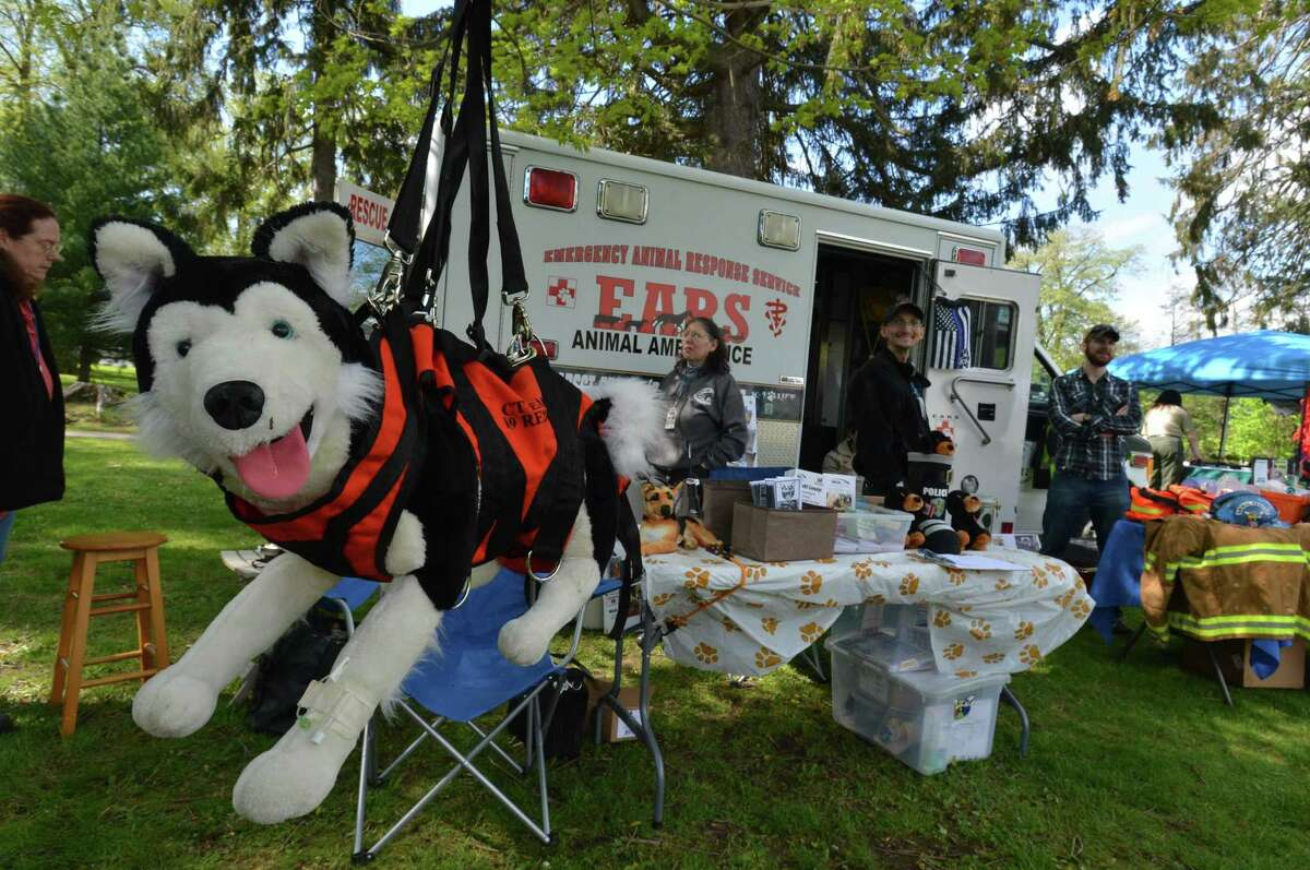 A toy husky sits in a sling at the Emergency Animal Response Service booth during the Westport Dog Festival. The event, in its second year is sponsored by the Weston Westport Chamber of Commerce and was held at Winslow Park on Sunday May 7, 2017 in Westport Conn.