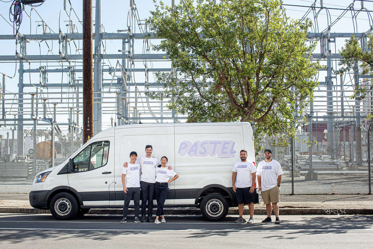 Pastel employees, left to right, Anh Mai, Chris Morewood, owner Amanda Nguyen, Luiz Castanheira Jr. and Ted Moran pose outside a delivery truck. The company delivers food items to customers in the Bay Area.