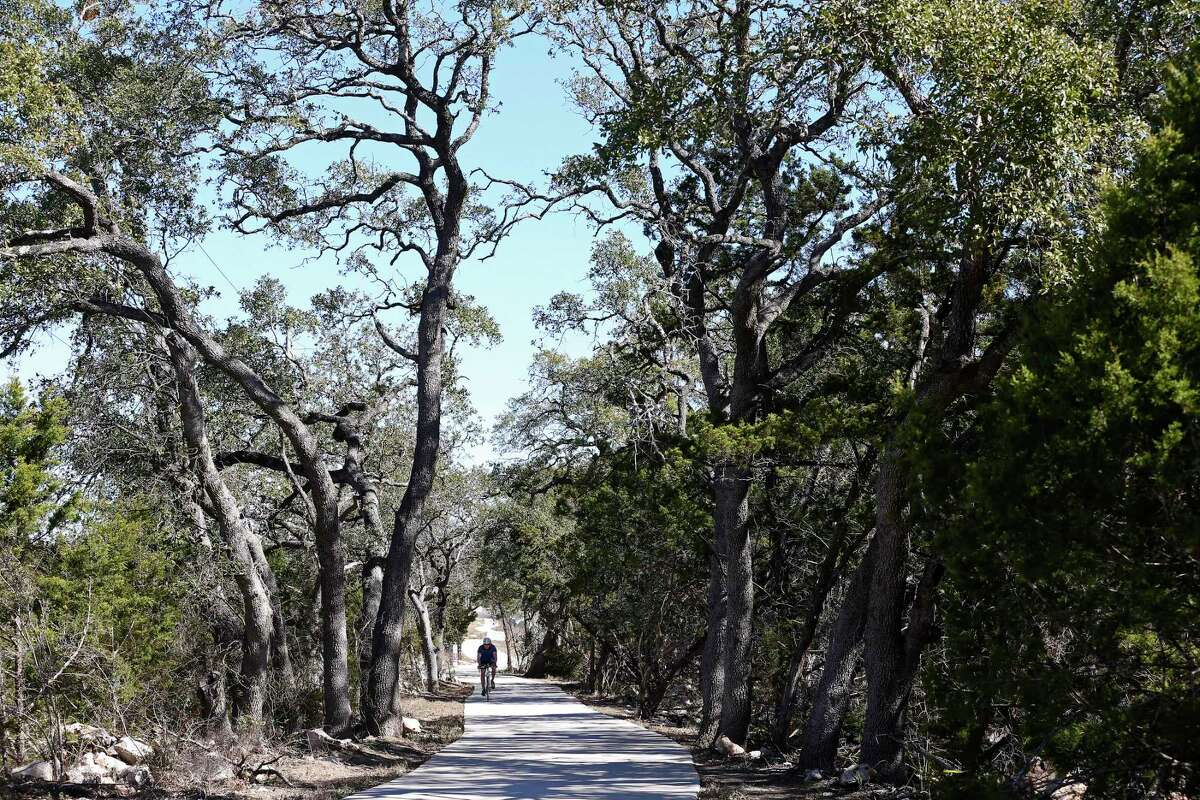 A cyclist uses the Salado Creek Greenway Trail near Eisenhower Park in February. Completing the greenway trail system should be at the top of the city's to-do list.