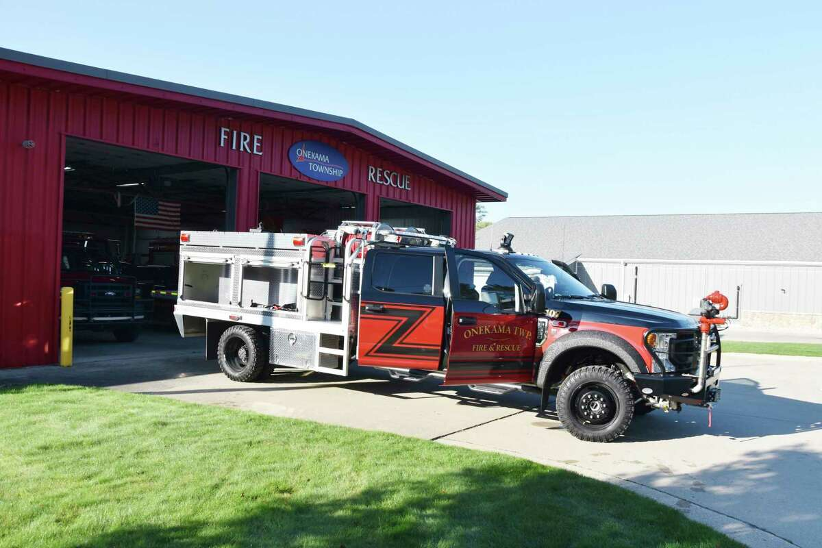 The Onekama Township Fire Rescue Department replaced its 2006 brush fire truck on Friday. Volunteer firefighters from the department were trained on how to use the new truck's features. (Arielle Breen/News Advocate)