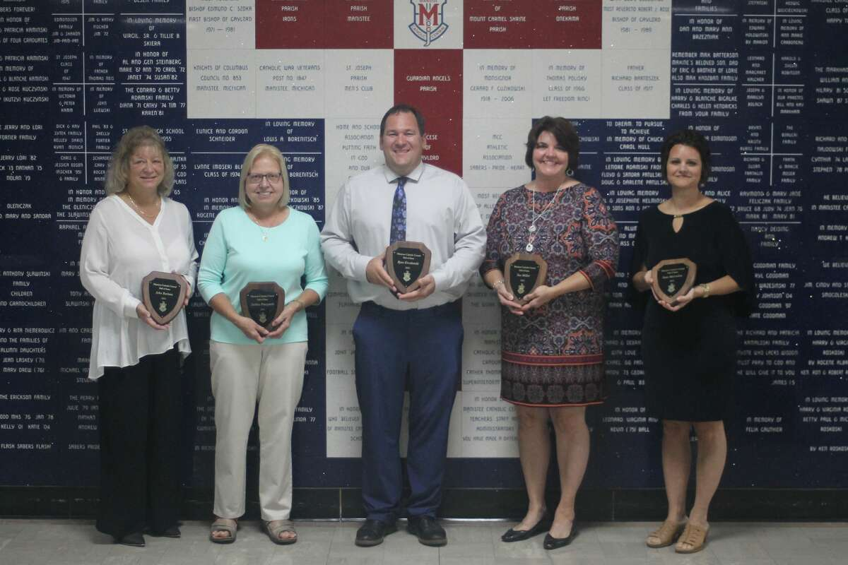 Manistee Catholic Central inducted six people into its Hall of Fame on Saturday. Pictured (from left) are Chris Bartosz, who accepted the honor on her husband John's behalf, Debbie Pieczynski, Ryan Kieszkowski, Sue Miller and Sam McLinden. Not pictured is Pat Zwiefka.