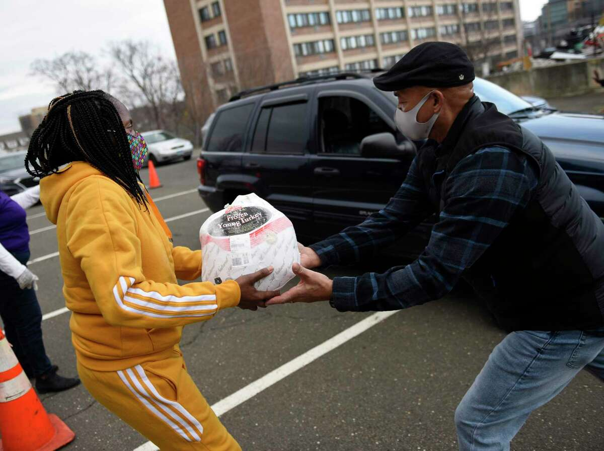 Turkeys are distributed at Bethel AME Church in Stamford, Conn. Wednesday, Nov. 25, 2020. 500 donated turkey dinners complete with a variety of Thanksgiving side dishes were distributed in drive-thru fashion at Bethel AME Church on Wednesday. In addition, gift cards and masks donated by the Stamford Police Department were handed out at the event.