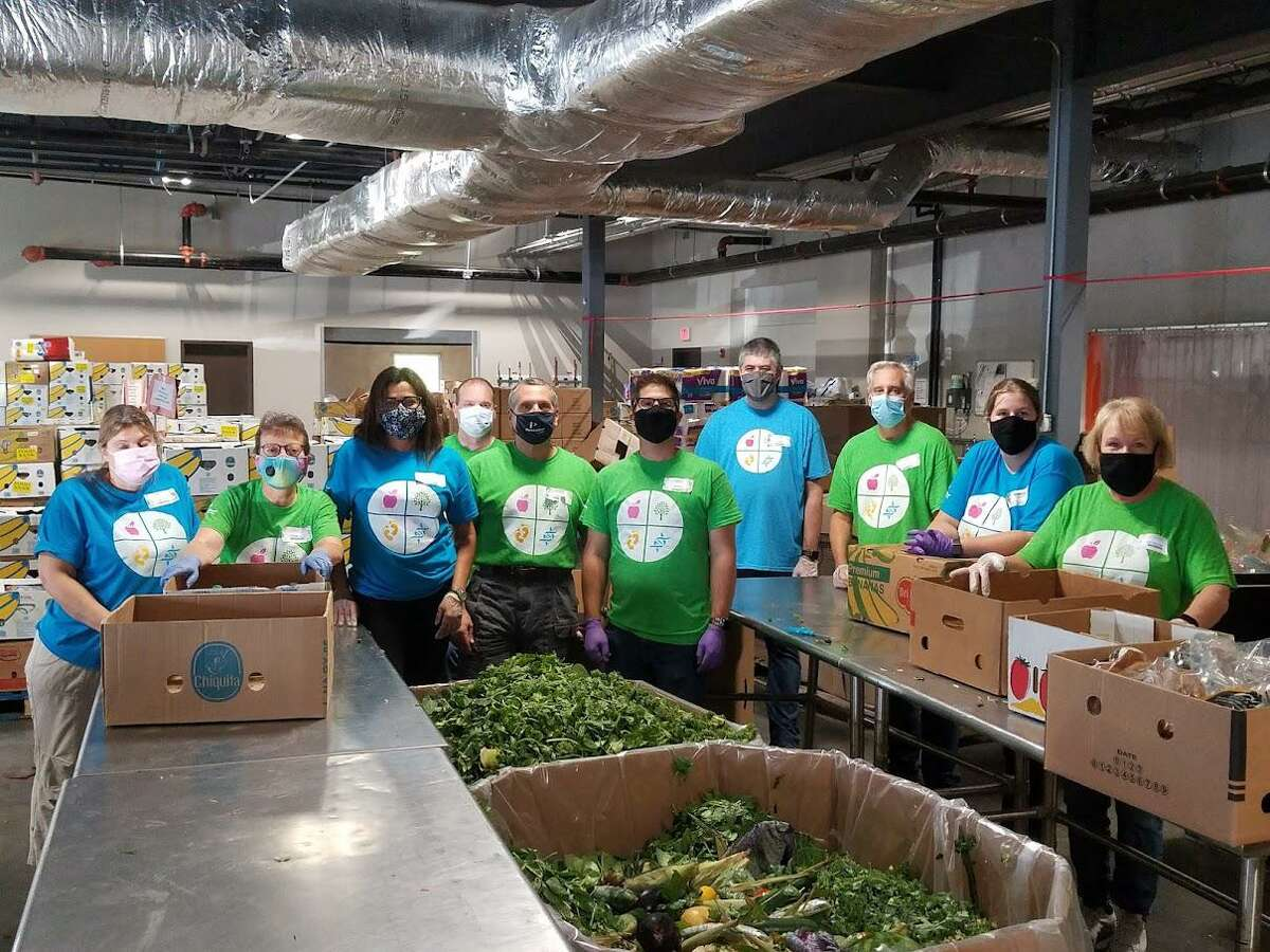 Employees at PerkinElmer's Shelton facility, sorted and packed almost 9,000 pounds of meat and produce at the Connecticut regional food bank distribution center in Wallingford as part of the company's Impact Day on Sept. 15, 2021.