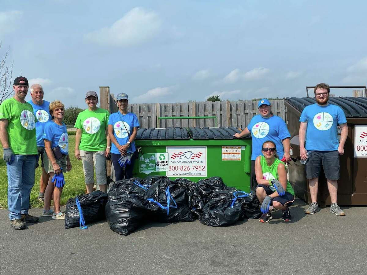 Employees at PerkinElmer's Shelton facility, removed 27 large bags of trash and debris at Walnut and Silver Sands beaches in Milford as part of the company's Impact Day on Sept. 15, 2021.
