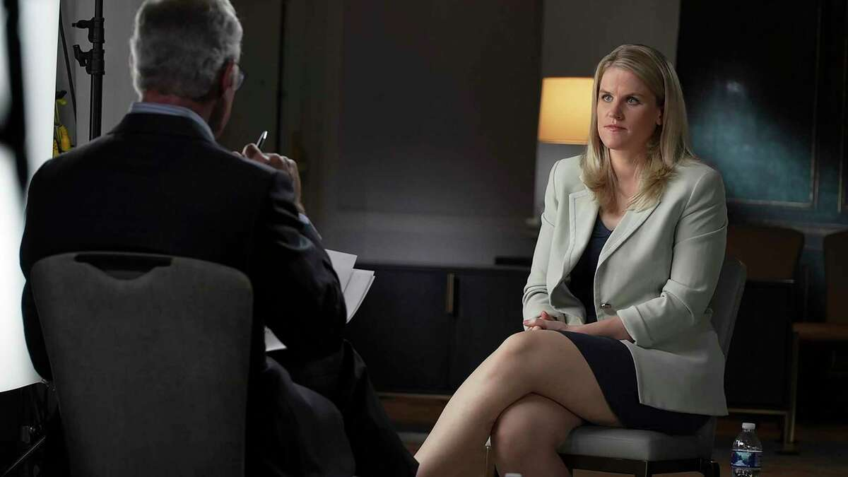 """In this Sept. 16, 2021, photo provided by CBS, Facebook whistle-blower Frances Haugen talks with CBS' Scott Pelley on """"60 Minutes,"""" in an episode that aired Sunday."""