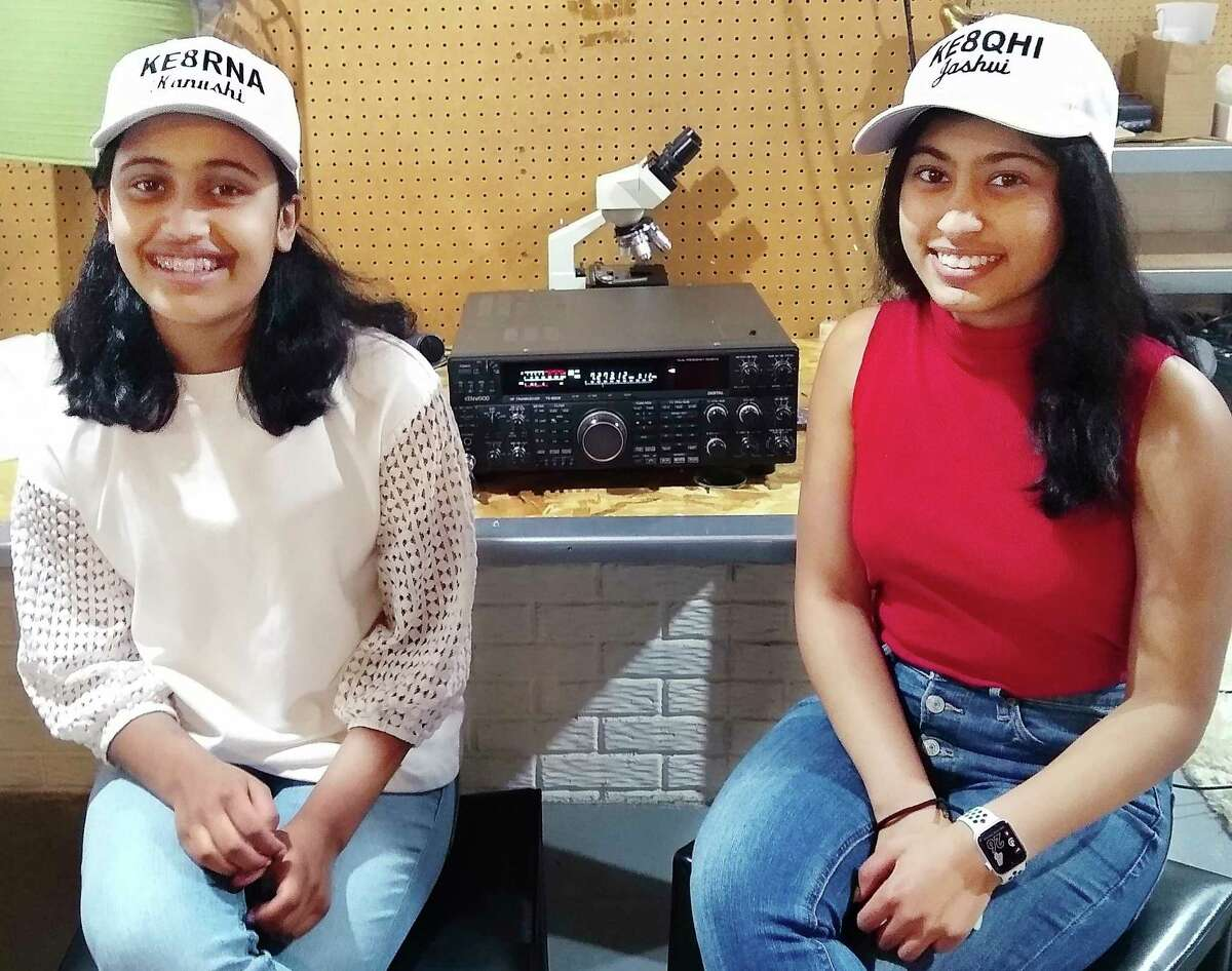 Sisters Kanushi Desai, left, and Jashvi Desai, right, pose for a photo wearing hats embroidered with their names and individual amateur radio call signs. The girls are proud owners of amateur radio licenses after passing both the FCC Technician Class and General Class Amateur Radio exams. (Photo provided/Dennis Klipa)