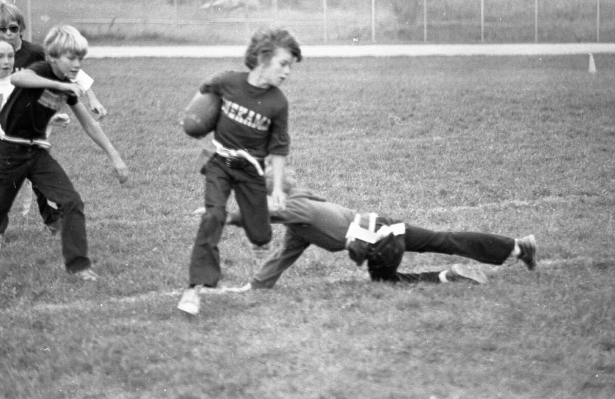 Children could be seen playing flag football in Onekama in early October, 1981. (Manistee County Historical Museum photo)
