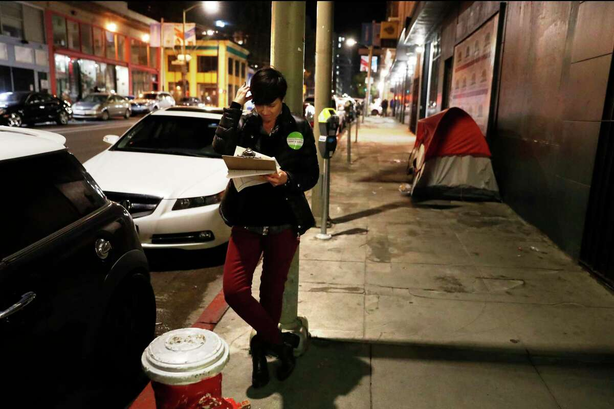 Margot Antonetty, a manager of supportive housing for San Francisco, takes part in the January 2019 Homeless Point-in-Time Count in the Tenderloin.