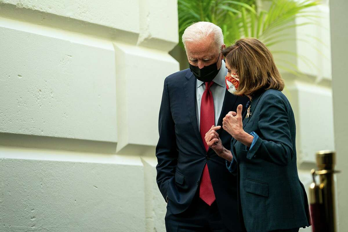 President Joe Biden and Speaker of the House Nancy Pelosi, D-California, leave a House Democratic Caucus meeting in the U.S. Capitol on Friday, Oct. 1, 2021, in Washington, D.C. The president called the meeting in order to push through an impasse with his $1 trillion infrastructure plan.