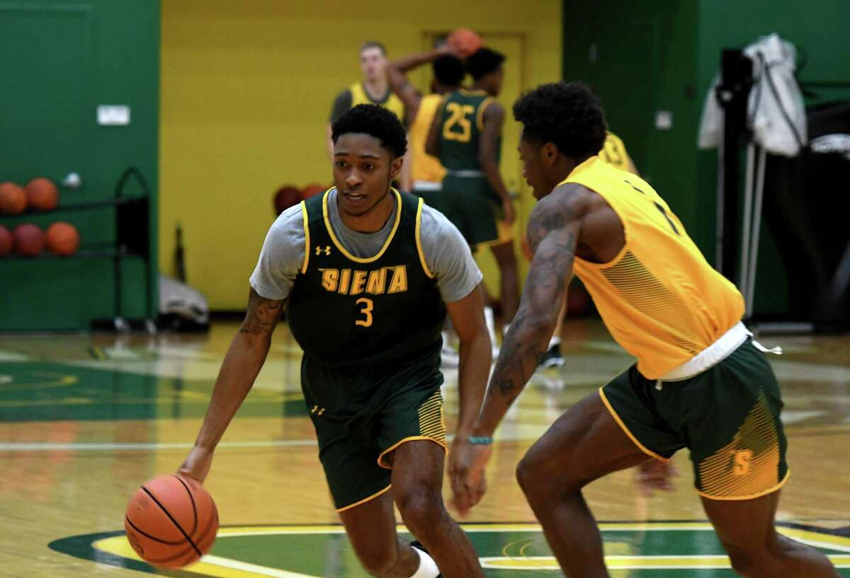 Siena College guard Colby Rogers, left, works on drills with teammate Jared Billups, right, during practice for the men?•s basketball team on Monday, Oct. 4, 2021, at the UHY Center on the Siena campus in Colonie, N.Y.