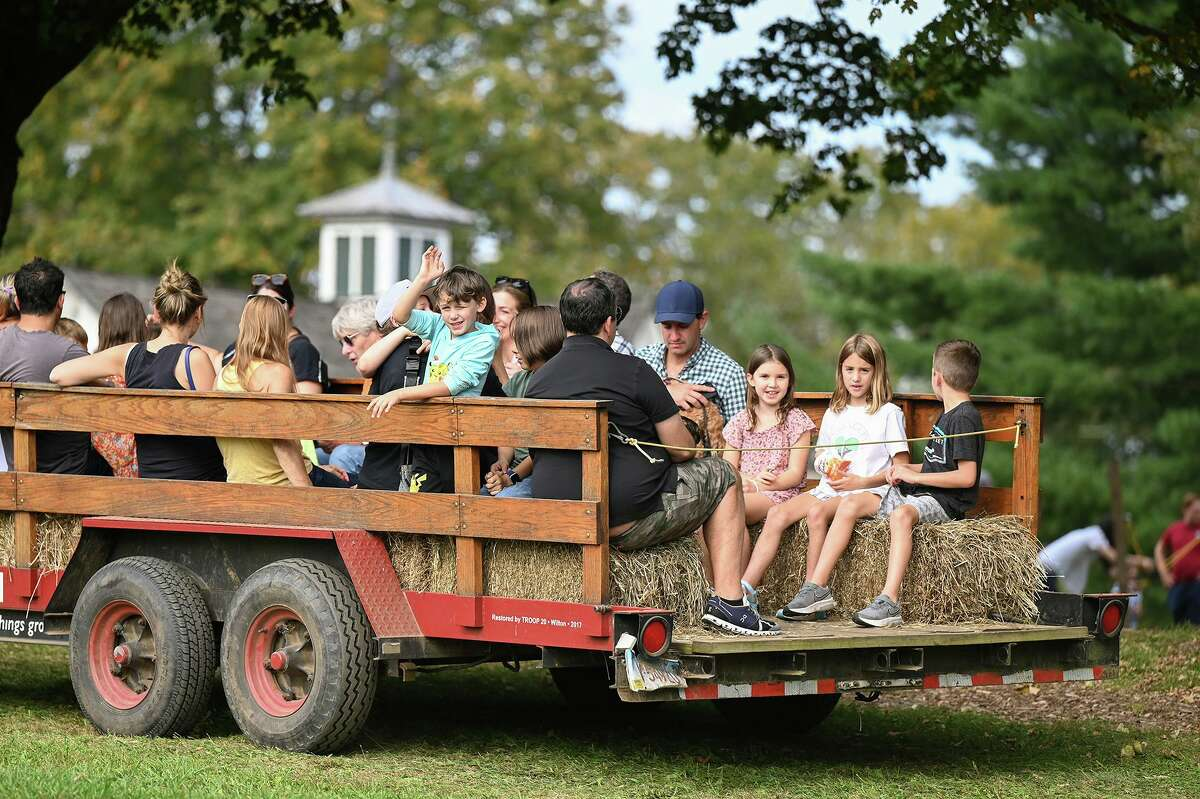 Visitors to Ambler Farm Day enjoyed a tractor hayride.