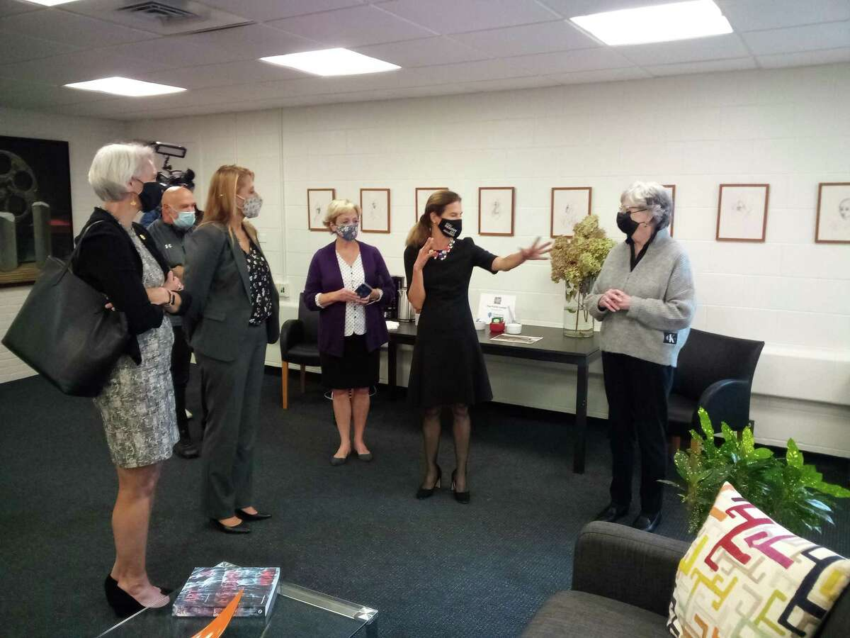 Lt. Gov. Susan Bysiewicz, second from right, gestures to Five Points Center for the Visual Arts Executive Director Judy McElhone during a visit to the center Monday.